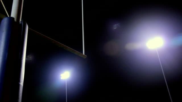 Goalpost-in-Stadium-at-Night