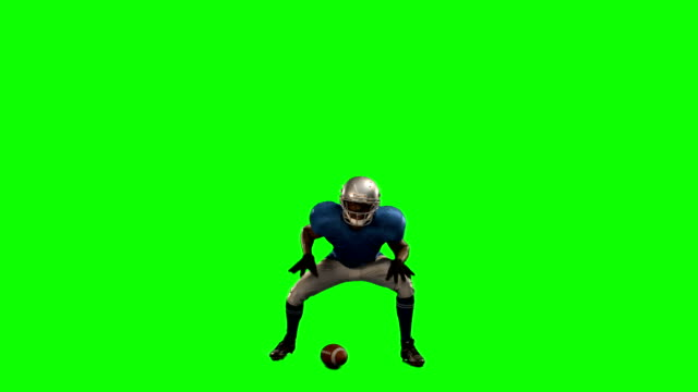 American-football-player-in-attack-stance
