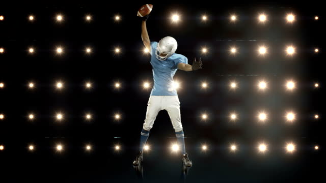 American-football-player-against-flashing-lights