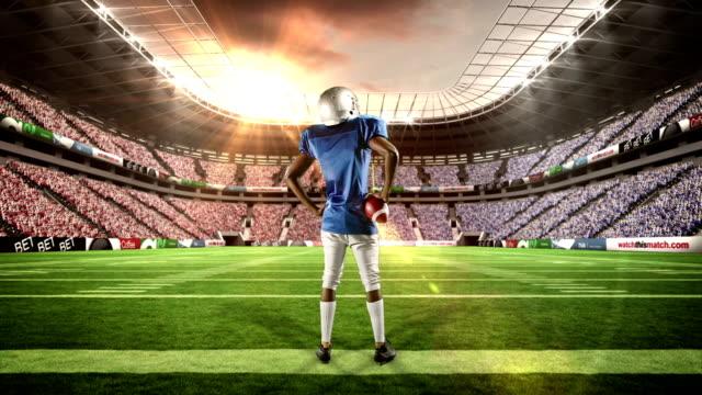 Jugador-de-fútbol-con-pelota-planteado-sus-brazos