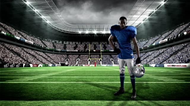 American-football-player-holding-his-helmet