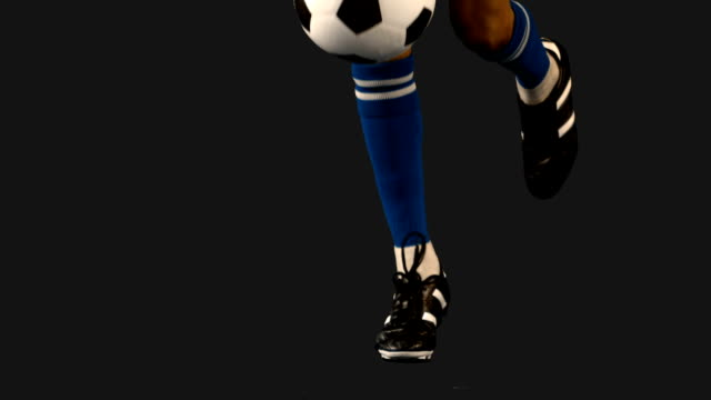 Football-player-controlling-the-ball