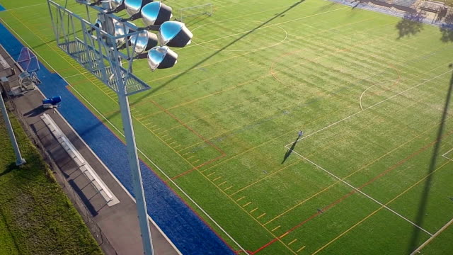 Flying-Over-an-Outdoor-Synthetic-Football-Field