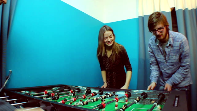 People-playing-table-soccer-team-building-socializing-resting