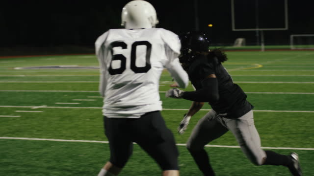 A-football-player-catches-a-pass-and-makes-a-touchdown-in-slow-motion