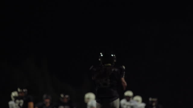 A-football-player-throws-the-ball-toward-the-camera-and-they-make-a-touchdown