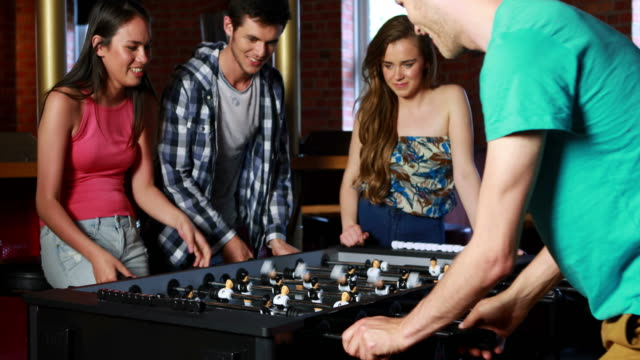Happy-friends-playing-table-football