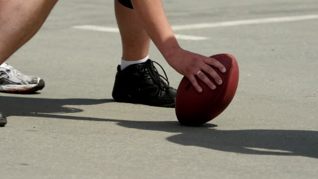 Close-up-view-of-football-player-hand-