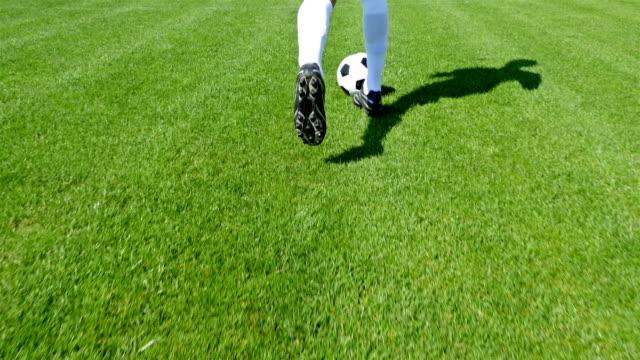 Footballer-leading-the-ball-on-a-football-field