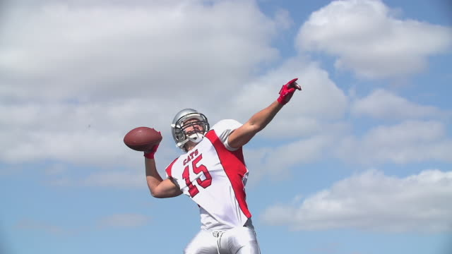 An-American-Football-Quarterback-throws-the-ball-and-celebrates-