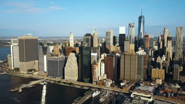 Aerial-view-of-the-capital-of-America---New-York-Drone-turning-around-the-Manhattan-east-river-and-Brooklyn-bridge