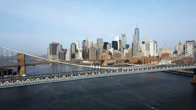 Aerial-view-of-the-New-York-America-Drone-flying-under-the-Manhattan-bridge-to-Brooklyn-bridge-through-the-East-river