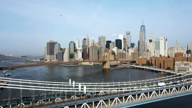 Aerial-view-of-downtown-in-New-York-America-Drone-flying-over-Manhattan-bridge-and-under-Brooklyn-bridge-acceleration