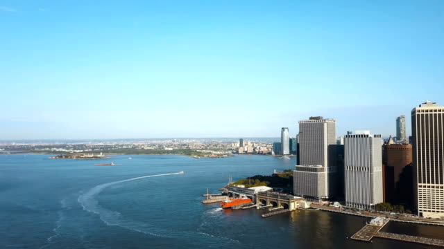 Aerial-view-of-the-Statue-of-liberty-in-the-distance-Manhattan-East-river-in-Manhattan-in-New-York-America