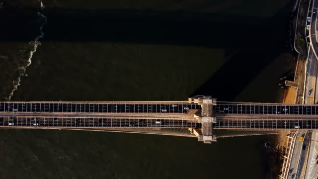 Aerial-view-of-Brooklyn-bridge-through-the-East-river-from-the-Manhattan-to-Brooklyn-in-New-York-America