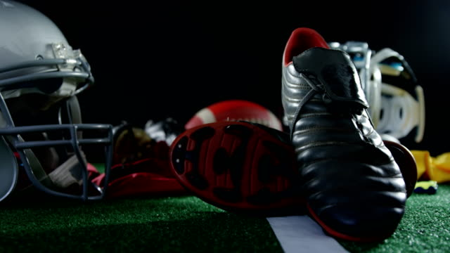 Various-sports-equipment-on-artificial-turf-4k
