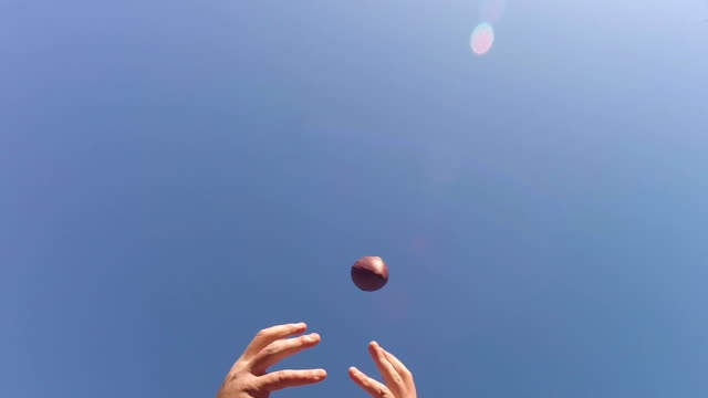 Dropping-football-pass-in-super-slow-motion