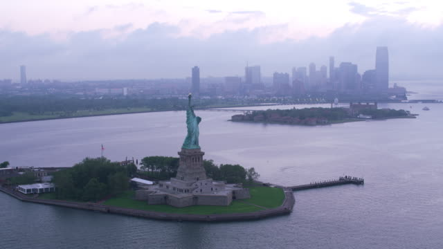 High-angle-approach-and-fly-over-Statue-of-Liberty-