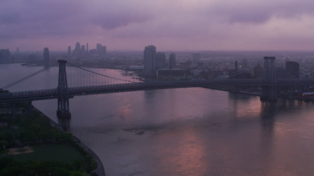 Flying-up-East-River-by-Williamsburg-Bridge-at-sunrise-