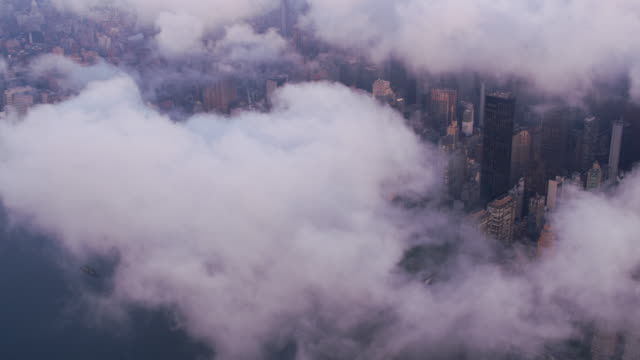 Aerial-view-of-Manhattan-with-low-clouds-at-sunrise-