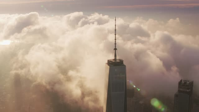 Sunrise-over-Manhattan-with-clouds-passing-One-World-Trade-Center-building-