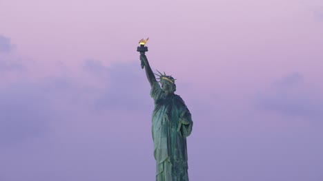 Low-angle-aerial-view-of-Statue-of-Liberty-at-sunrise-