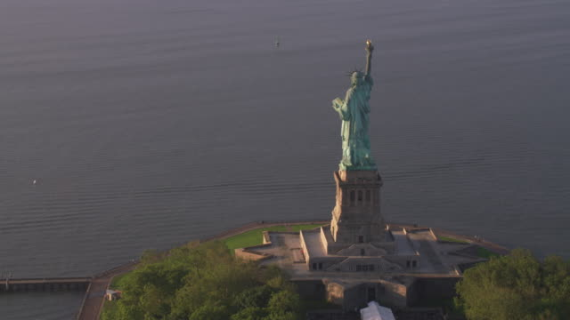 Aerial-view-of-Statue-of-Liberty-at-sunrise-Manhattan-