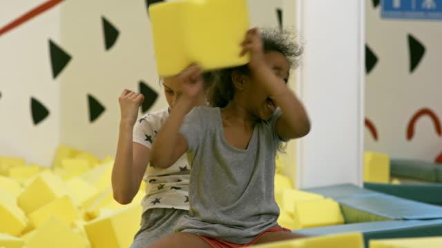 Multiethnic-Girls-Together-in-Indoor-Playground
