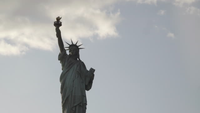 Close-up-shot-of-Statue-of-Liberty-filmed-in-the-sunset-from-the-river-in-New-York-United-States-of-America