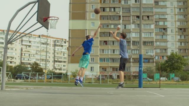 Streetball-player-taking-jump-shot-on-basketball-court