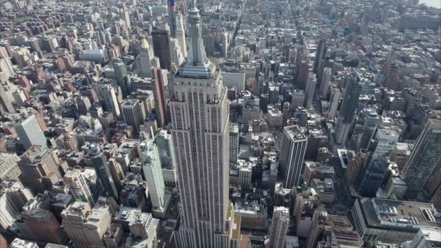 NYC-Aerial-Top-to-Front-Shot-Of-Empire-State-Viewing-Downtown