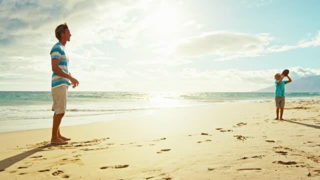 Father-Son-Having-Fun-at-the-Beach