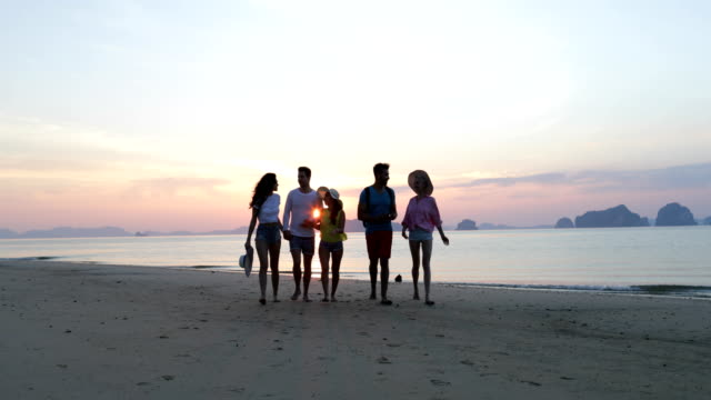 People-Talking-On-Beach-At-Sunset-Walking-Young-Tourists-Group-Communication