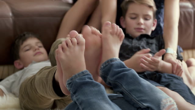 The-boys-leaned-their-feet-against-each-other-and-fooled-around