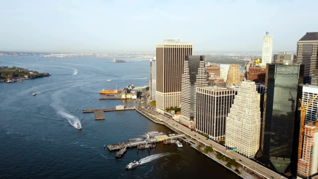 Aerial-view-of-the-Manhattan-in-New-York-America-Drone-flying-away-from-the-shore-of-East-river-business-part-of-city