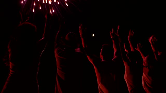 Cheering-crowd-of-people-celebrating-fourth-of-july-with-fireworks