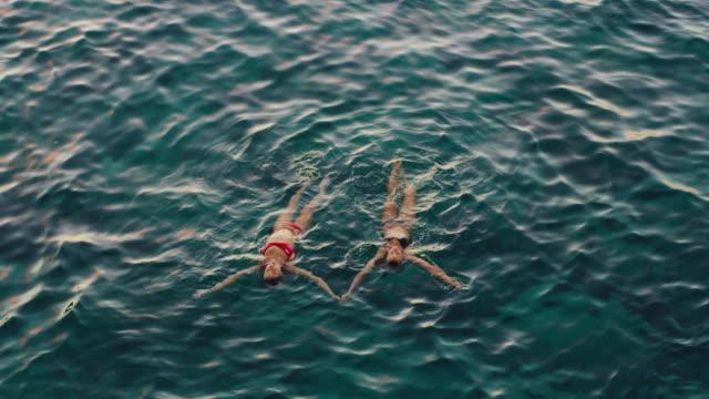 Girls-Relaxing-in-the-Ocean