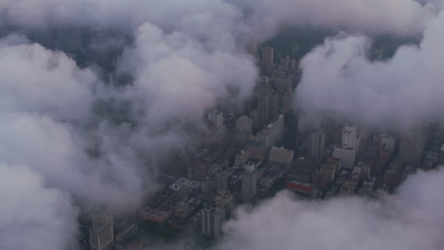 Aerial-view-looking-through-low-clouds-at-Manhattan-