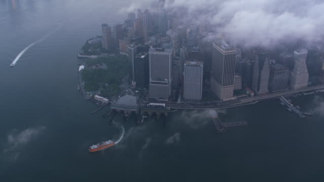 High-angle-aerial-view-of-lower-Manhattan-with-low-clouds-