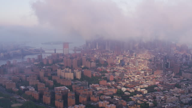 Aerial-view-of-low-clouds-over-Manhattan-and-East-River-