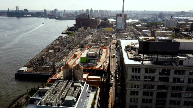 Aerial-view-of-the-Brooklyn-district-in-New-York-America-Drone-flying-over-the-building-on-the-shore-of-East-river