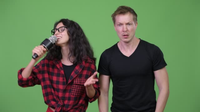 Young-couple-singing-together