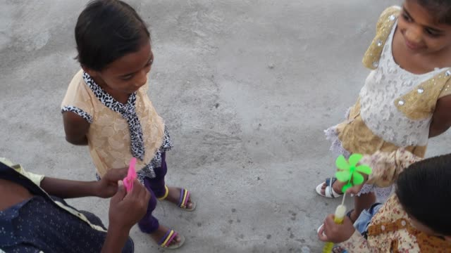 Indian-children-blowing-bubbles-and-playing-with-friends