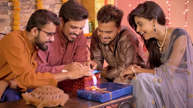 Good-looking-office-colleagues-using-an-application-or-shopping-online-on-a-cell-phone-during-Diwali