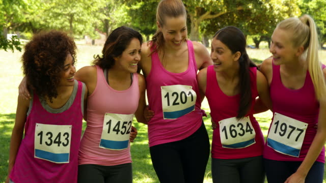 Happy-woman-racing-pink-for-breast-cancer-awareness