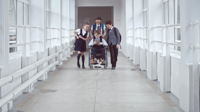 Handicapped-Schoolboy-Chatting-with-Friends
