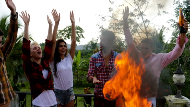 Young-People-Cheerful-Cooking-Barbecue-Happy-Frineds-Group-Raise-Hands-Gathering-On-Summer-Terrace-Having-Party