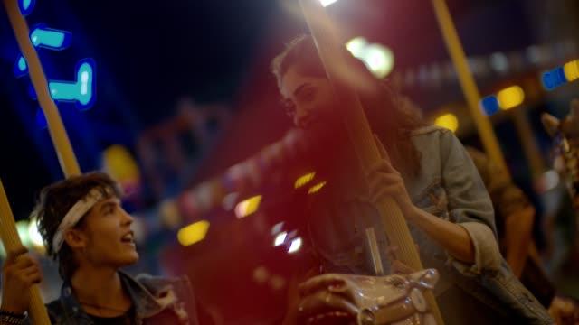 Teenage-couple-kissing-on-amusement-park-carousel-ride
