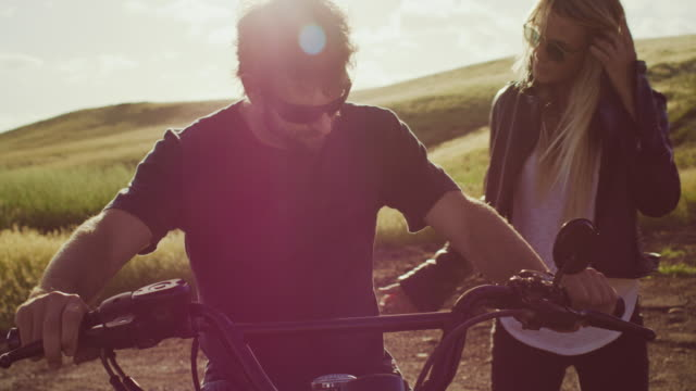 Couple-on-Motorcycle-Watching-the-Sunset