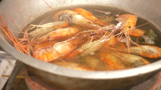 4k-close-up-someone-cooks-shrimps-in-a-saucepan-Slow-motion